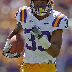 October 1, 2011; Baton Rouge, LA, USA;  LSU Tigers wide receiver Odell Beckham (33) runs after a catch for a touchdown against the Kentucky Wildcats during the second quarter at Tiger Stadium.  Mandatory Credit: Derick E. Hingle-US PRESSWIRE / © Derick E. Hingle 2011