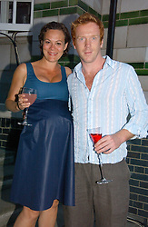 Actor DAMIAN LEWIS and actress HELEN McCROY at a party to celebrate FilmFour becoming the UK's first major free film channel held at Debenham House, Addison Road, London on 20th July 2006.<br /><br />NON EXCLUSIVE - WORLD RIGHTS