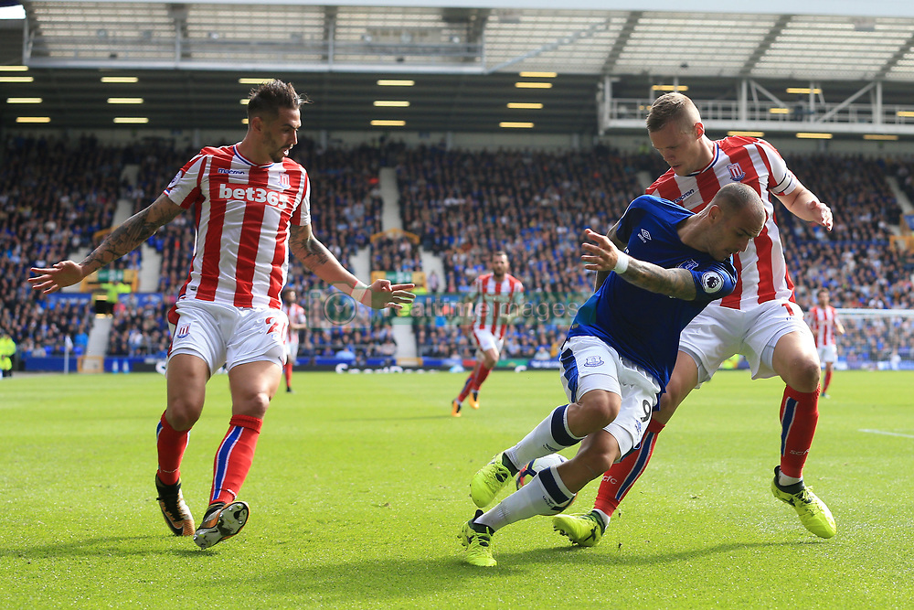 12th August 2017 - Premier League - Everton v Stoke City - Sandro Ramirez of Everton battles with Geoff Cameron of Stoke (L) and Ryan Shawcross of Stoke - Photo: Simon Stacpoole / Offside.