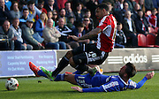 Andre Gray getting fouled by Danny Fox during the Sky Bet Championship match between Brentford and Nottingham Forest at Griffin Park, London, England on 6 April 2015. Photo by Matthew Redman.