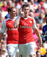 Football - 2016 / 2017 Premier League - Arsenal vs. Everton<br /> <br /> Laurent Koscielny of Arsenal takes off his Captain's arm band after being sent off by referee Michael Oliver at The Emirates.<br /> <br /> COLORSPORT/ANDREW COWIE