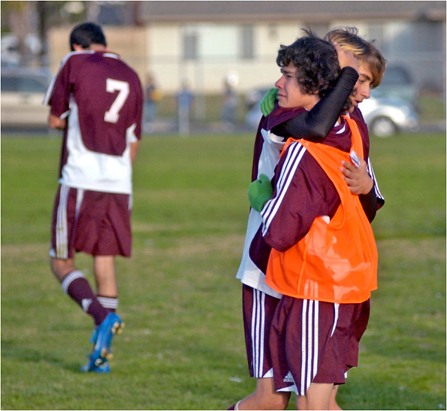 Michael Stenerson / Staff Photographer.Granite Hills teammates Cameron Westlake and Anthony Avila console each other after their 2-0 loss to Los Amigos high school Tuesday.
