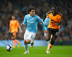 WIGAN, ENGLAND - Monday, March 29, 2010: Manchester City's Carlos Tevez and Wigan Athletic's Mohamed Diame during the Premiership match at the City of Manchester Stadium. (Photo by David Rawcliffe/Propaganda)