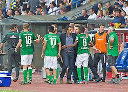 10.08.2013, Eintracht Stadion, Braunschweig, GER, 1. FBL, Eintracht Braunschweig vs SV Werder Bremen, 1. Runde, im Bild Robin Dutt (Cheftrainer SV Werder Bremen) schnaubt nach Abpfiff durch, waehrend er Cedrick Makiadi (SV Werder Bremen #6) umarmt  during the German Bundesliga 1st round match between Eintracht Braunschweig and SV Werder Bremen at the Eintracht stadium, Braunschweig, Germany on 2013/08/10. EXPA Pictures © 2013, PhotoCredit: EXPA/ Andreas Gumz <br /> <br /> *****ATTENTION - OUT OF GER*****