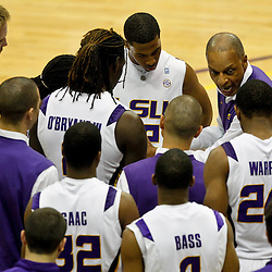 January 2, 2012; Baton Rouge, LA; LSU Tigers head coach Trent Johnson huddles with his team during the second half of a game against the Virginia Cavaliers at the Pete Maravich Assembly Center. Virginia defeated LSU 57-52.  Mandatory Credit: Derick E. Hingle-US PRESSWIRE