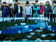 PAJU, GYEONGGI, SOUTH KOREA:  South Korean tourists look at a relief map of the DMZ in Odusan Unification Observatory, a tourist attraction that overlooks the DMZ. Tourism to the Korean DeMilitarized Zone (DMZ) has increased as the pace of talks between South Korea, North Korea and the United States has increased. Some tours are sold out days in advance.     PHOTO BY JACK KURTZ