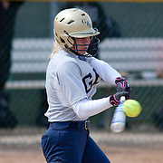 Goldey-Beacom pitcher Roni Peters (6) makes contact with the ball in the fifth inning of game #1 of NCAA Central Atlantic Collegiate Conference (doubleheader) against Post University Saturday, March 30, 2013, at Nancy Churchmann Sawin Athletic Field in Wilmington Delaware.