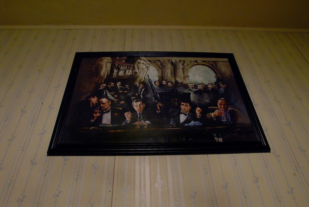 A poster of hollywood mobsters and mafia leaders hangs at the B-House during an all night party in Gary, Indiana. Members of the B-House deal in narcotics and prostitution. Tony Montana (Scarface,) The Godfather and Tony Sooprano are often cited as heros by criminals in Gary.