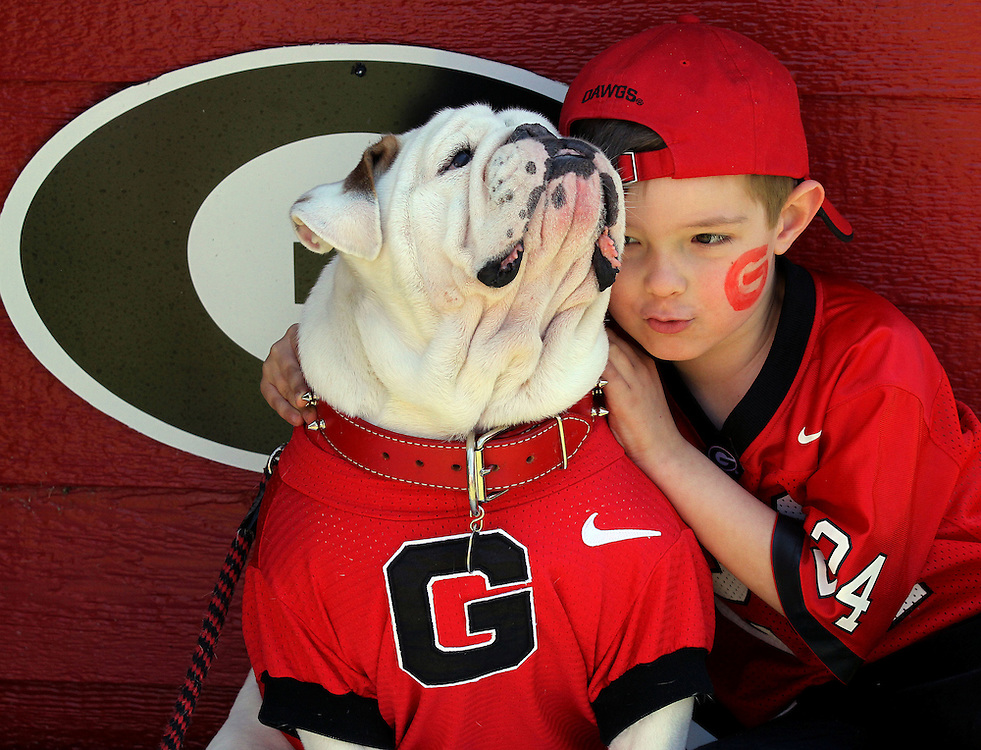 """Jones Kendall, age 6, poses with mascot """"UGA IX"""" before UGA's G-Day football game at Sanford Stadium in Athens."""