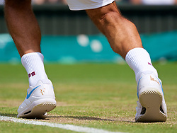 LONDON, ENGLAND - Monday, July 9, 2018: The RF branded Nike shoe of Roger Federer (SUI) during the Gentlemen's Singles 4th Round match on day seven of the Wimbledon Lawn Tennis Championships at the All England Lawn Tennis and Croquet Club. (Pic by Kirsten Holst/Propaganda)
