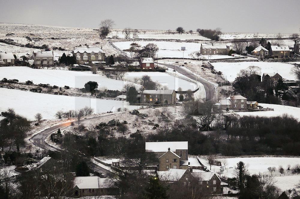 &copy; Licensed to London News Pictures. <br /> 29/01/2015. <br /> <br /> Danby, United Kingdom<br /> <br /> Houses and fields in Danby in North Yorkshire are covered in snow. A wintery blast causing extremely cold weather is expected to cause some disruption over the next few days.<br /> <br /> Photo credit : Ian Forsyth/LNP