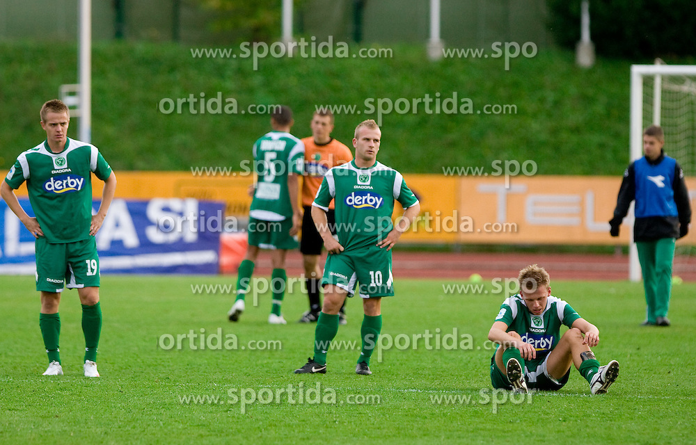 Rok Roj, Enes Rujovic and Andrej Dugolin of Olimpija dissapointed after the 13th Round of Prva Liga football match between NK Olimpija and Maribor, on October 17, 2009, in ZAK Stadium, Ljubljana. Maribor won 1:0. (Photo by Vid Ponikvar / Sportida)
