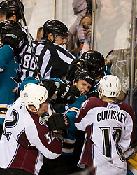 April 16, 2010; San Jose, CA, USA; San Jose Sharks center Scott Nichol (bottom, center) fights with Colorado Avalanche defenseman Adam Foote (52) during the second period of game two in the first round of the 2010 Stanley Cup Playoffs at HP Pavilion.  The Sharks defeated the Avalanche 6-5 in overtime. Mandatory Credit: Jason O. Watson / US PRESSWIRE