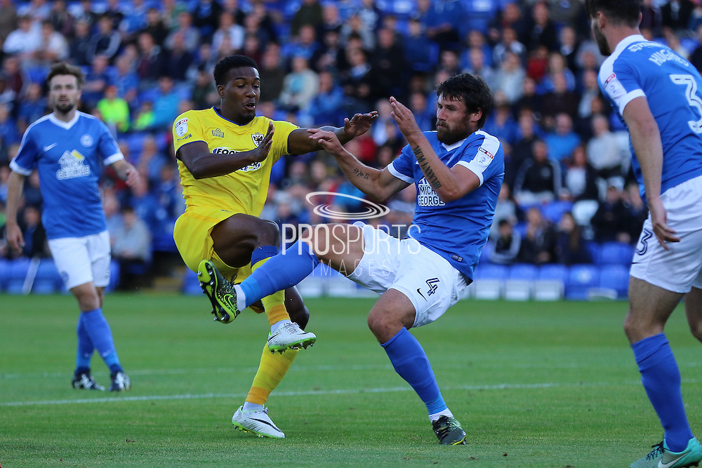 AFC Wimbledon striker Dominic Poleon (10) and Peterborough United midfielder Michael Bostwick (4) during the EFL Cup match between Peterborough United and AFC Wimbledon at ABAX Stadium, Peterborough, England on 9 August 2016. Photo by Stuart Butcher.