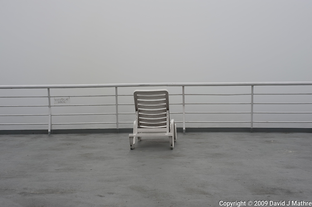Lone Deck Chair on Misty Morning. Solarium Deck on the M/V Columbia Alaska Marine Highway Between Bellingham, Washington and Haines, Alaska. Image taken with a Nikon D3 and 50mm f/1.4 lens (ISO 200, 50 mm, f/8, 1/1000 sec).