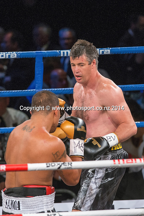 Brad `Hollywood` Pitt (R) fights Vaitele SoI in the Mahindra Super 8 Fight Night, North Shore Events Centre, Auckland, New Zealand, Saturday, November 22, 2014. Photo: David Rowland/Photosport