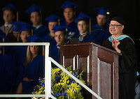 "Guidance Counselor Monica Sawyer brings laughs and tears during her keynote address as she tells students to ""find what brings them joy"" during Gilford High School commencement Saturday morning at Bank of NH Meadowbrook Pavillion.   (Karen Bobotas/for the Laconia Daily Sun)"