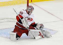 Apr 15, 2009; Newark, NJ, USA; Carolina Hurricanes goalie Cam Ward (30) makes a glove save during the first period of game one of the eastern conference quarterfinals of the 2009 Stanley Cup playoffs at the Prudential Center.