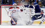 Tampa Bay Lightning's Victor Hedman (R) scores past Montreal Canadiens goalie Carey Price during the third period of an NHL hockey game in Tampa, Florida February 12, 2013.  REUTERS/Mike Carlson (UNITED STATES)