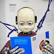 iCub è un robot androide costruito dall'Istituto Italiano di Tecnologia (IIT) di Genova. Alto 104 cm e pesa 22 kg,    The iCub is the humanoid robot developed at IIT as part of the EU project RobotCub and subsequently adopted by more than 20 laboratories worldwide. It has 53 motors that move the head, arms & hands, waist, and legs. It can see and hear, it has the sense of proprioception (body configuration) and movement (using accelerometers and gyroscopes).  Torino 12 maggio 2016