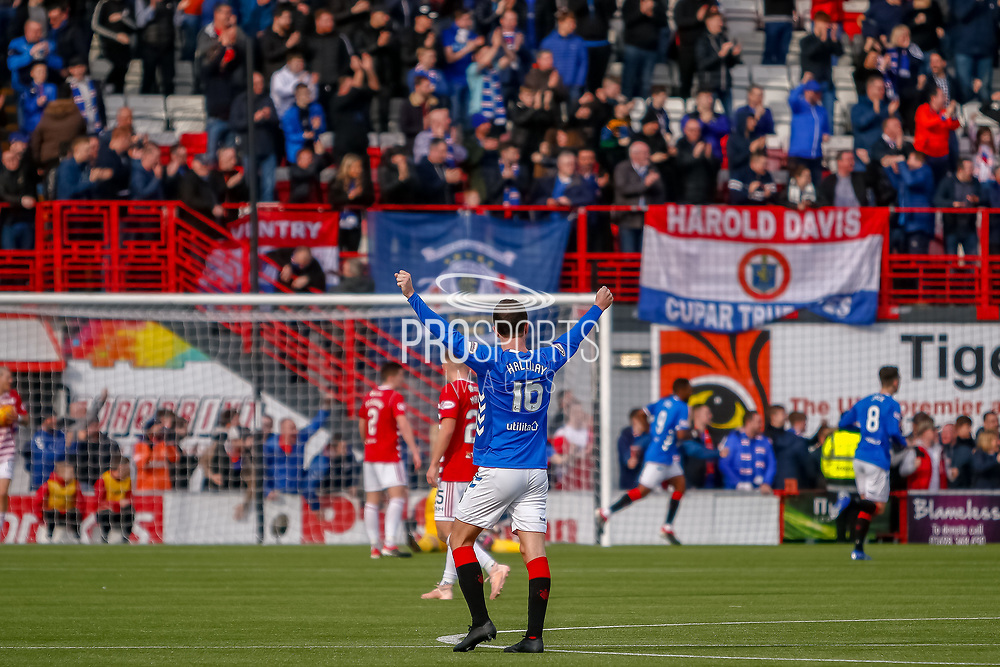 Andy Halliday holds his arms aloft as rangers secure the points with their 4th goal in front of the traveling fans during the Ladbrokes Scottish Premiership match between Hamilton Academical FC and Rangers at The Hope CBD Stadium, Hamilton, Scotland on 24 February 2019.