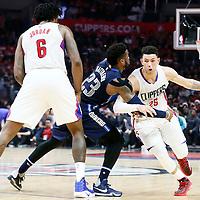 23 December 2016: LA Clippers guard Austin Rivers (25) drives past Dallas Mavericks guard Wesley Matthews (23) on a screen set by LA Clippers center DeAndre Jordan (6) during the Dallas Mavericks 90-88 victory over the LA Clippers, at the Staples Center, Los Angeles, California, USA.