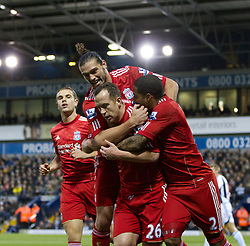 WEST BROMWICH, ENGLAND - Saturday, October 29, 2011: Liverpool's Charlie Adam celebrates scoring the first goal against West Bromwich Albion from the penalty spot with team-mate Glen Johnson, Jordan Henderson and Andy Carroll during the Premiership match at The Hawthorns. (Pic by Vegard Grott/Propaganda)