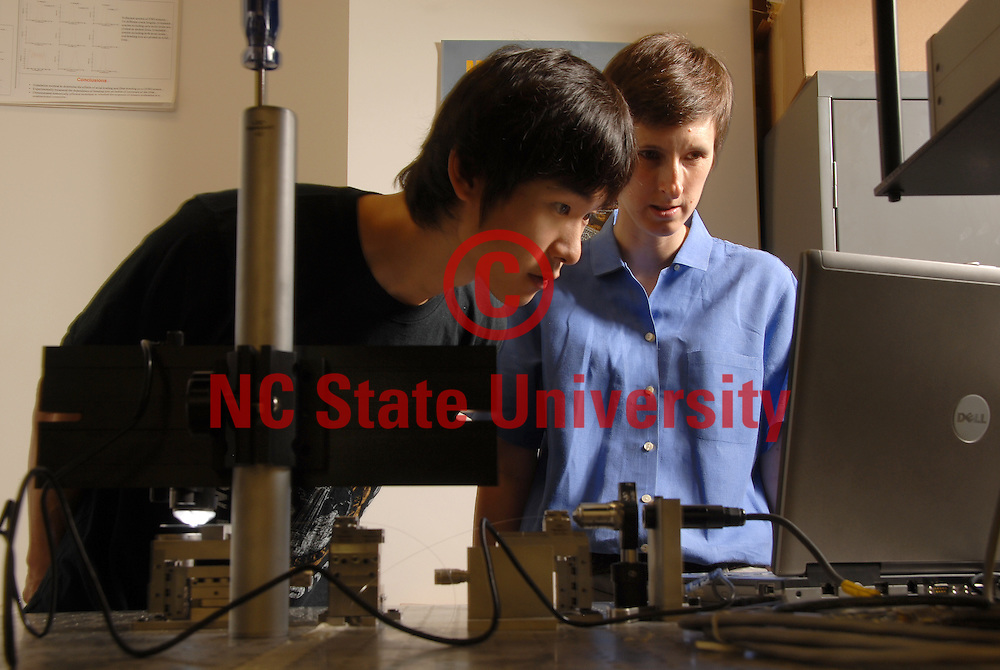 Engineering student Young Jun Song (left) discusses his work with researcher Kara Peters in their Broughton Hall lab. PHOTO BY ROGER WINSTEAD