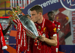 LIVERPOOL, ENGLAND - Wednesday, July 22, 2020: Liverpool's James Milner kisses with the Premier League trophy as the Reds are crowned Champions after the FA Premier League match between Liverpool FC and Chelsea FC at Anfield. The game was played behind closed doors due to the UK government's social distancing laws during the Coronavirus COVID-19 Pandemic. (Pic by David Rawcliffe/Propaganda)