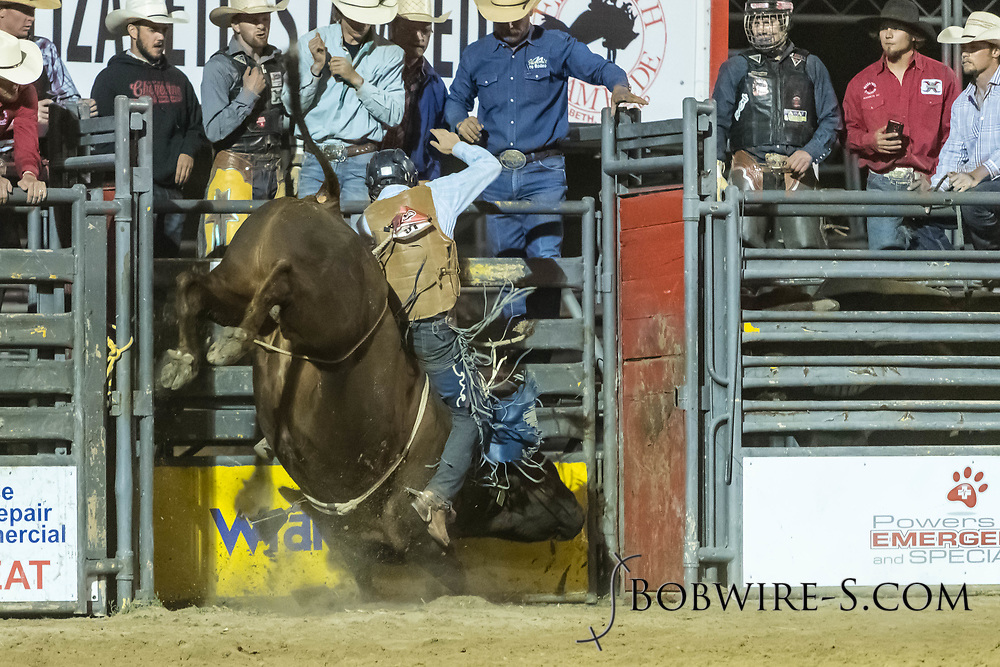 Bull rider Anthony Green rides Summit Pro Rodeo's Red Image in the second performance of the Elizabeth Stampede on Saturday, June 2, 2018.