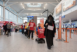 © Licensed to London News Pictures. 18/01/2019. Bristol Airport, Lulsgate, North Somerset, UK. Extinction Rebellion hold a protest in the departure hall at Bristol Airport, to protest against plans to expand the airport and against frequent flying which they say causes both pollution and climate change. Molly Scott Cato, MEP for south west England, spoke in support. Photo credit: Simon Chapman/LNP
