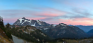 An early fall sunset in Washington State's North Cascades Range featuring Mount Shuksan. Also pictured are Shuksan Arm (left) and Kulshan Ridge/Huntoon Point (middle).  I haven't been able to name the peak or mountain in the right foreground, unfortunately.  Photographed from the Chain Lakes trail in the Mount Baker Wilderness though Mount Shuksan itself lies in North Cascades National Park.