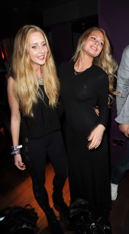 Left to right, sisters SOPHIA GREENE and LUCY GREENE at the Tatler Little Black Book Party held at Chinawhite, 4 Winsley Street, London on 20th November 2009.