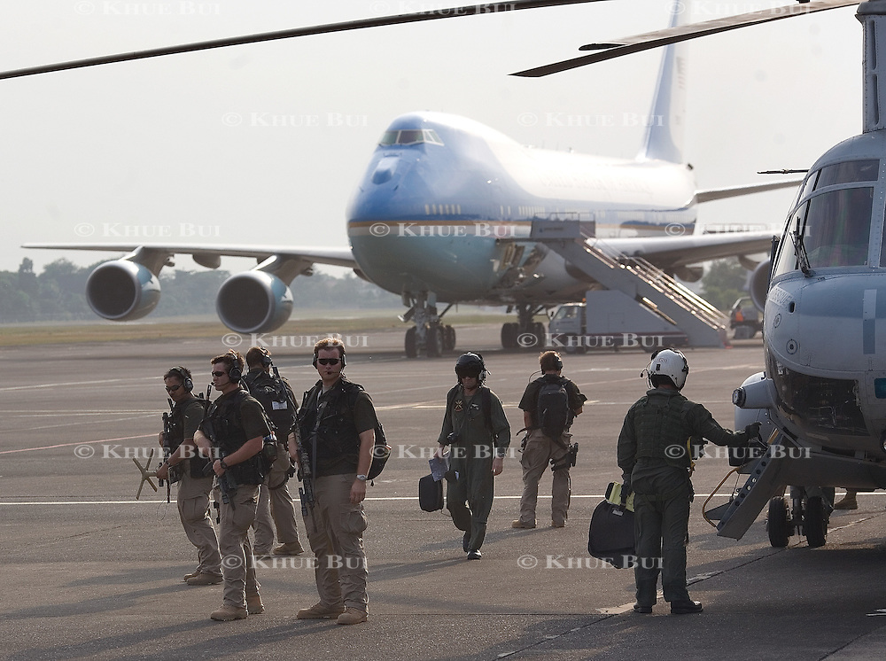 Unidentified security personnel provide security as President Bush and First Lady Laura Bush walk to their helicopter surrounded by US Secret Service at Halim Air Force Base to meet with  the President of Indonesia Susilo Bambang Yudhoyono Monday, November 20, 2006, in Bogor, Indonesia.  In the background is Air Force One...Photo by Khue Bui