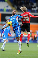 Hull's Tom Huddlestone is challenged by Cardiff's Mats Daehli. .Barclays Premier league, Cardiff city v Hull city match at the Cardiff city Stadium in Cardiff, South Wales on Saturday 22nd Feb 2014.<br /> pic by Andrew Orchard, Andrew Orchard sports photography.