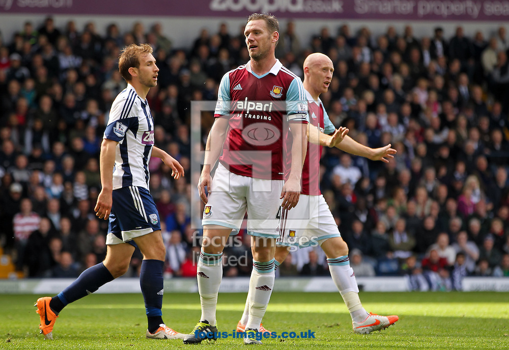 Kevin Nolan (centre) of West Ham United reacts to missing a good chance to score during the Barclays Premier League match at The Hawthorns, West Bromwich<br /> Picture by Tom Smith/Focus Images Ltd 07545141164<br /> 26/04/2014