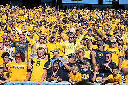 Oct 14, 2017; Morgantown, WV, USA; West Virginia Mountaineers fans celebrate after beating the Texas Tech Red Raiders at Milan Puskar Stadium. Mandatory Credit: Ben Queen-USA TODAY Sports