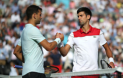Serbia's Novak Djokovic (right) shakes hands with Bulgaria's Grigor Dimitrov (left) after winning the match during day four of the Fever-Tree Championship at the Queen's Club, London.