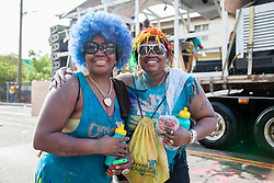 (L-R) Othille Henry and Sheryl Nolan.  Carnival 2015 continues Jouvert morning on the Watefront.  St. Thomas, VI.  30 April 2015.  © Aisha-Zakiya Boyd