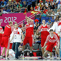 10 August 2012: Russia bench players celebrate during 67-59 Team Spain victory over Team Russia, during the men's basketball semi-finals, at the North Greenwich Arena, in London, Great Britain.