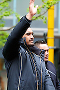 Jerome Kaino waves to the crowd while the New Zealand All Blacks, 2011 Rugby World Cup champions, parade through the streets of Wellington. Rain and strong wind wasn't enough to deter Wellington locals from welcoming their heroes.