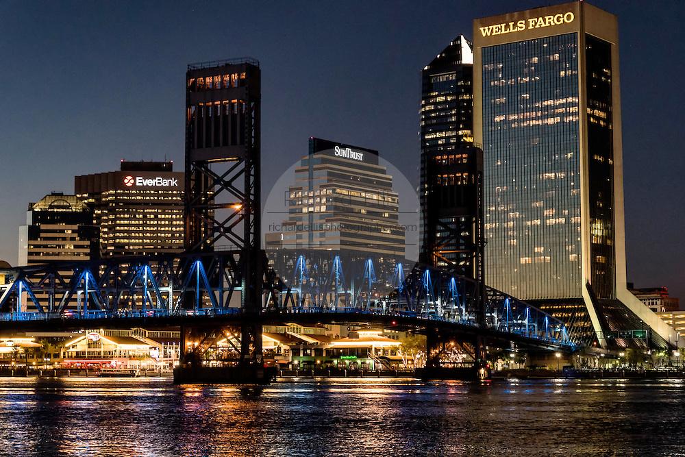 City skyline from the Southbank Riverwalk along the St. John's River at sunset in Jacksonville, Florida.