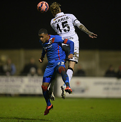 Jake Harris of Weston Super Mare wins a high ball over Doncaster Rovers's Reece Wabara - Photo mandatory by-line: Alex James/JMP - Mobile: 07966 386802 - 18/11/2014 - SPORT - Football - Weston-super-Mare - Woodspring Stadium - Weston-super-Mare v Doncaster - FA Cup - Round One