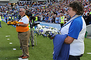Flower bearers in memory of the Shoreham Air disaster victims the Sky Bet Championship match between Brighton and Hove Albion and Hull City at the American Express Community Stadium, Brighton and Hove, England on 12 September 2015.