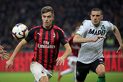 March 2, 2019 - Milan, Milan, Italy - Krzysztof Piatek #19 of AC Milan competes for the ball with Merih Demirl #3 of US Sassuolo during the serie A match between AC Milan and US Sassuolo at Stadio Giuseppe Meazza on March 02, 2019 in Milan, Italy. (Credit Image: © Giuseppe Cottini/NurPhoto via ZUMA Press)