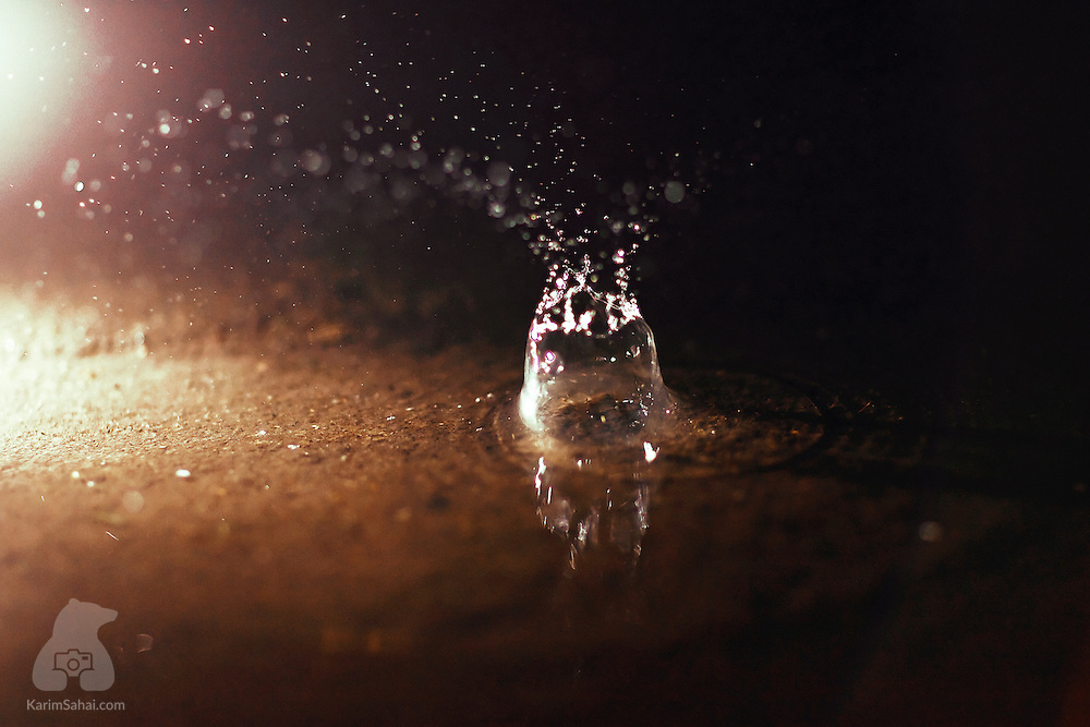 A water droplet creates a  splash when hitting the ground.