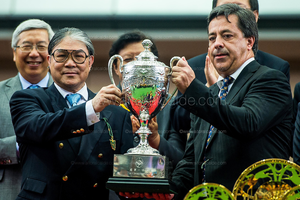 HONG KONG - MAY 04:  (R) Timothy Fok give the trophy to (L) Ingrid Jooste after wining The Champions Mile at Sha Tin racecourse on May 4, 2014 in Hong Kong, Hong Kong.  (Photo by Aitor Alcalde/Getty Images)