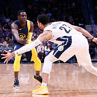03 April 2018: Indiana Pacers guard Darren Collison (2) passes the ball past Denver Nuggets guard Jamal Murray (27) during the Denver Nuggets 107-104 victory over the Indiana Pacers, at the Pepsi Center, Denver, Colorado, USA.