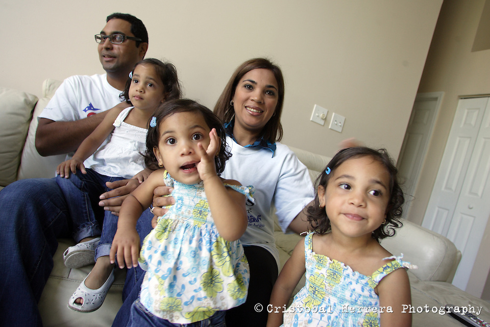 Hugo Gonzalez, retired US Army Specialist, left, poses next to his wife Any and theirs daughters Lelanni, 3, Lela, 3 and Loralee, 2 at his home in Hollywood on Tuesday June 16, 2009. An improvised explosive device injured Gonzalez on June 21, 2004, while serving is the US Army in Iraq.  Staff photo/Cristobal Herrera....