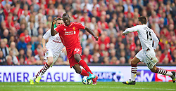 13.09.2014, Anfield, Liverpool, ENG, Premier League, FC Liverpool vs Aston Villa, 4. Runde, im Bild Liverpool's Mario Balotelli in action against Aston Villa // during the English Premier League 4th round match between Liverpool FC and Aston Villa at the Anfield in Liverpool, Great Britain on 2014/09/13. EXPA Pictures &copy; 2014, PhotoCredit: EXPA/ Propagandaphoto/ David Rawcliffe<br /> <br /> *****ATTENTION - OUT of ENG, GBR*****